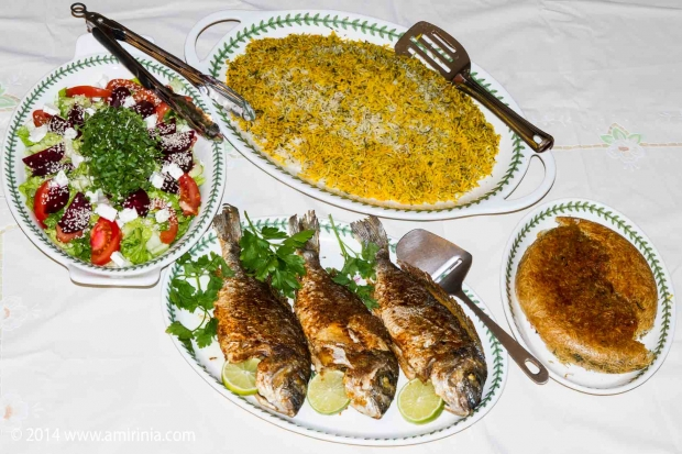 Iranians eat Sabsi polo Mahi on Iranian New Years Eve. It consists of Rice mixed with herbs and Fish