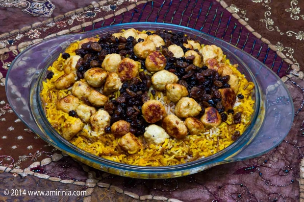 Iranians eat Reshteh polo on 1st day of Iranian New Year. It consists of Rice Macaroni and chicken meat balls.