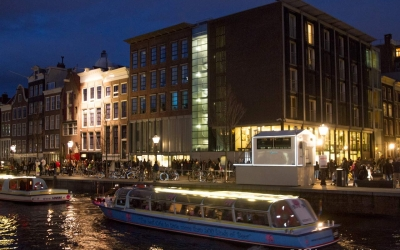 view of Ann Frank house from the canal at night