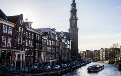 view of Ann Frank house and Westerkerk (17th century church)  from the canal